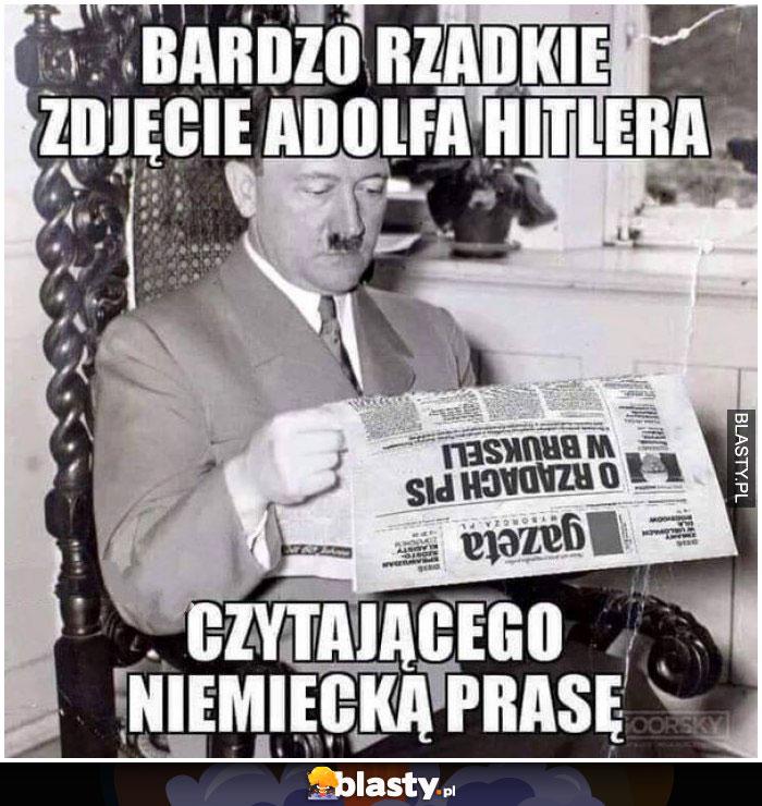Rzadkie zdjęcie Hitler czytającego niemiecką prasę