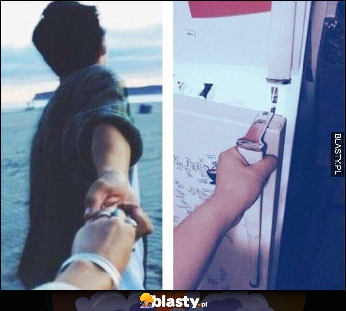 Dziewczyna trzyma chłopaka za rękę tak samo jak trzyma lodówkę